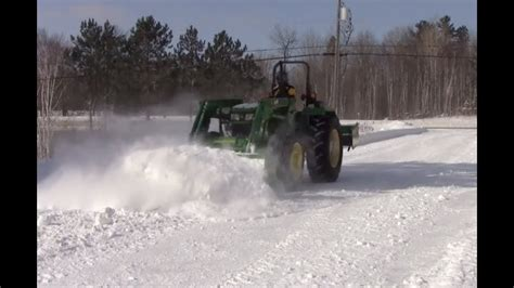Plowing snow with John Deere 5055E - YouTube